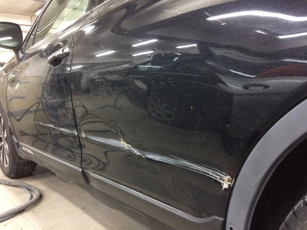 Фото повреждений дверей BMW